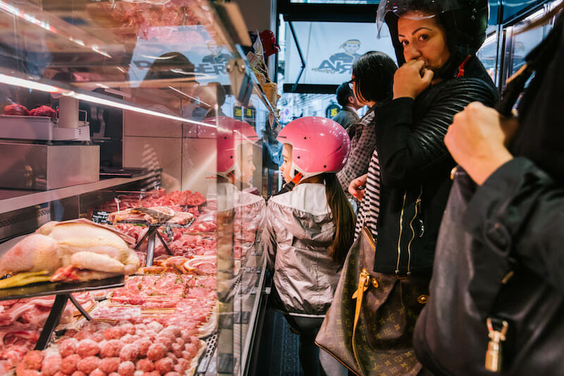 NAPLES, ITALY - 30 MAY 2019: Customers are seen here at D'Ausilio, a butcher shop in Naples, Italy, on May 30th 2019.<br /> Raffaele D'Ausilio comes from a family of butchers. His grandfather, Alfredo d'Ausilio, opened a butcher shop in 1947. All four of his children became butchers, including Raffaele's father Vincenzo. In the early 2000s, Raffaele and his wife Roberta took over the family business with their touch of innovation: a butcher shop during the day, a take-away burger shop at night.