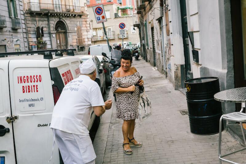 Beppe Sica, the pizzaiolo (pizza maker) of the Osteria Totò Eduardo e Pasta e Fagioli, jokes around with a local, photo by Gianni Cipriano and Sara Smarrazzo