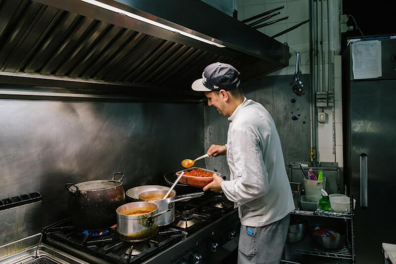 Chef Gaetano Bianchini, Mario Bianchini's son, cooks in the kitchen, photo by Gianni Cipriano and Sara Smarrazzo