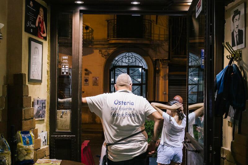 Beppe Sica tosses pizza dough, photo by Gianni Cipriano and Sara Smarrazzo