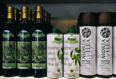 Moria Elea olive oil (right) at Pantopoleion tis Mesogeiakis Diatrofis, photo by Manteau Stam