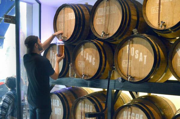 Filling a jug at Casa Mariol, photo by Paula Mourenza