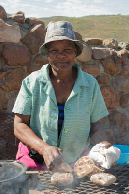 Elsie Claassen and her roosterkoek, photo by Marie Viljoen