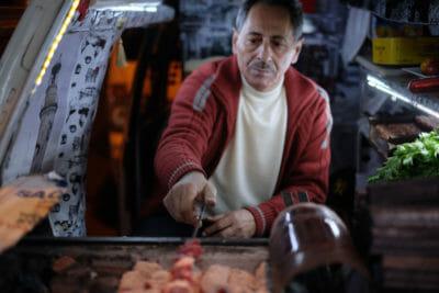Süleyman Usta grilling kebab out of Yıldırım Usta's van, photo by Paul Benjamin Osterlund