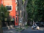 A typical morning scene in Coyoacán: a tamale vendor rides his cart through the streets.