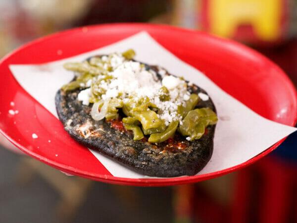 A tlacoyo sold at Sullivan market, photo by Ben Herrera
