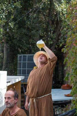 Àngel Aznar drinks from the porró at Peratallada's Medieval Festival, photo by Sam Zucker