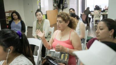 Rosario speaking at the street vendor meeting, photo by Sarah Khan