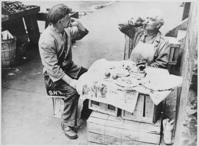 Two street vendors take a lunch break, August 1946, photo courtesy of the U.S. National Archives and Records Administration