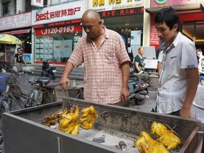 Mr. Li grilling chicken and pigeon at the Muslim market, photo by UnTour Shanghai