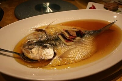 Whole fish symbolizing abundance for Chinese New Year, photo by UnTour Shanghai