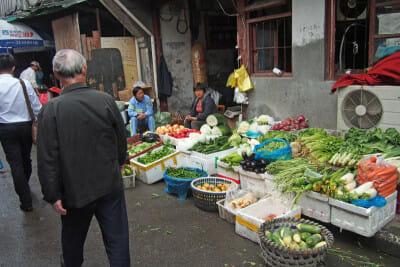 Vegetable seller at a wet market, photo by UnTour Shanghai